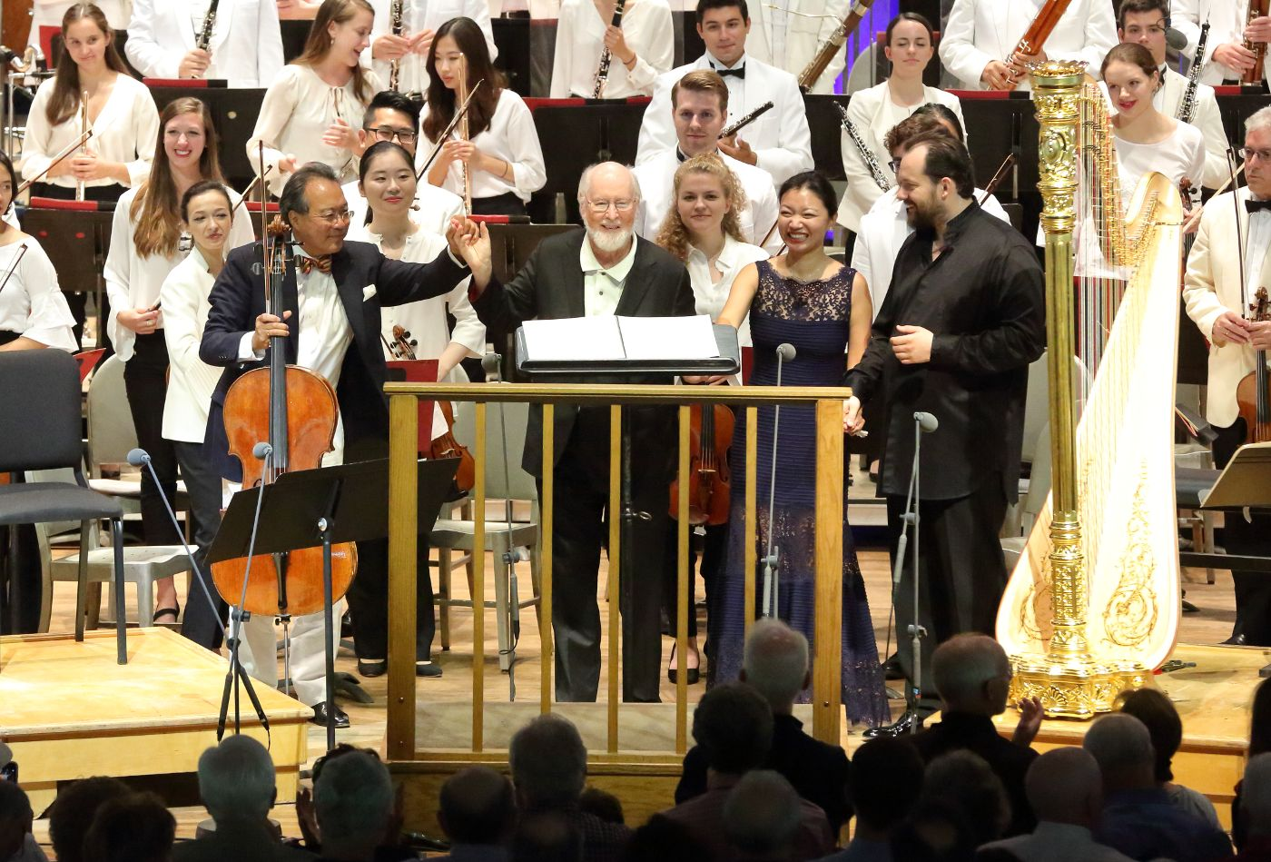 Yo-Yo Ma, John Williams, Jessica Zhou, and Andris Nelsons bow following the world premiere of Highwood's Ghost with the Tanglewood Music Center Orchestra at Tanglewood Aug.19, 2018; photo by Hilary Scott.